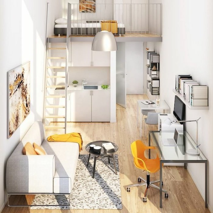 light-grey-sofa-studio-apartment-how-to-decorate-a-small-living-room-metal-staircase-glass-office-table-wooden-floor
